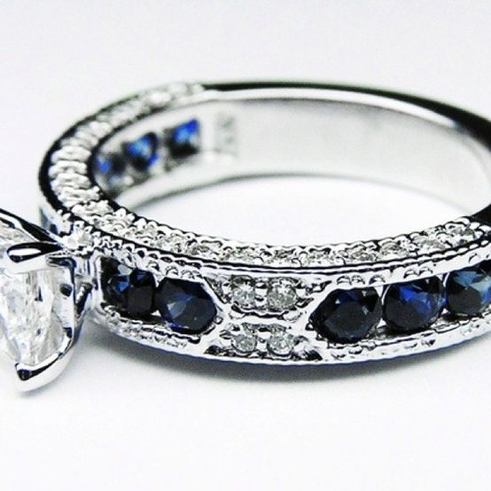 Holy hannahbanana! This is absolutely stunning! I love the idea of sapphire in a wedding ring but this baby probably set this guy back a long way. I could never expect something so expensive. A simple band is enough for this girl. But this is super pretty