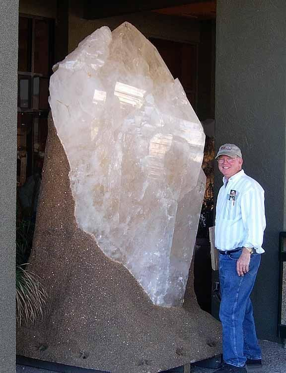 Mineral crystals grow under a variety of conditions. Slow cooling of magma (melted rock) deep within the Earth generally leads to a rock such as granite with visible crystals of feldspar, quartz, mica, amphibole and other minerals. Water in the magma can