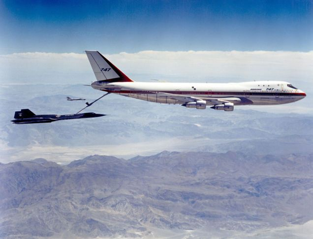 The Advanced Tanker-Cargo Aircraft, or ATCA, was first proposed by officials from the US Air Force's Strategic Air Command in 1967.  Here, a crew in an SR-71 (Air Force serial number 61-7955) connects with the 747 while an F-111 crew flies safety chas