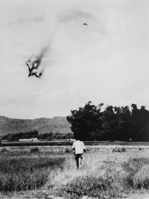 VIETNAM HIDDEN PHOTOS  An American F-105 warplane is shot down and the pilot ejects and opens  his parachute in this photo taken by North Vietnamese photograper Mai  Nam on September 1966 near Vinh Phuc, north of Hanoi. This photo is  one of the most reco
