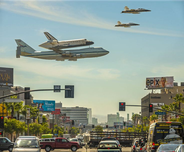 A Space Shuttle Over Los Angeles   Image Credit & Copyright: Stephen Confer.   It's not every day that a space shuttle lands at LAX. Although this was a first for the major Los Angeles airport hub, it was a last for the space shuttle Endeavour, as