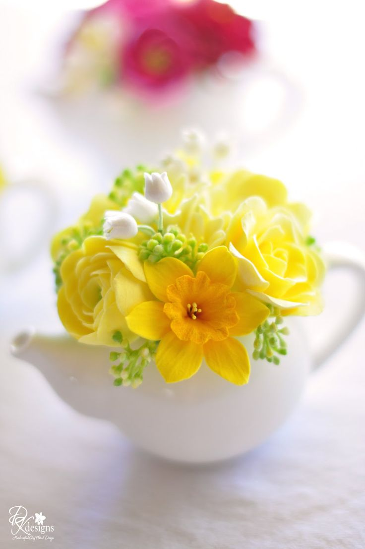 Mother's Day Tea Party Decor: Mini Teapots filled with hyacinth, ranunculus, roses & daffodils / DK Designs: Tea Party, Spring Flower, Teapots Filled, Mothers, Tea Pot, Flower Arrangements, Flowers, Mini Teapots, Yellow Flower