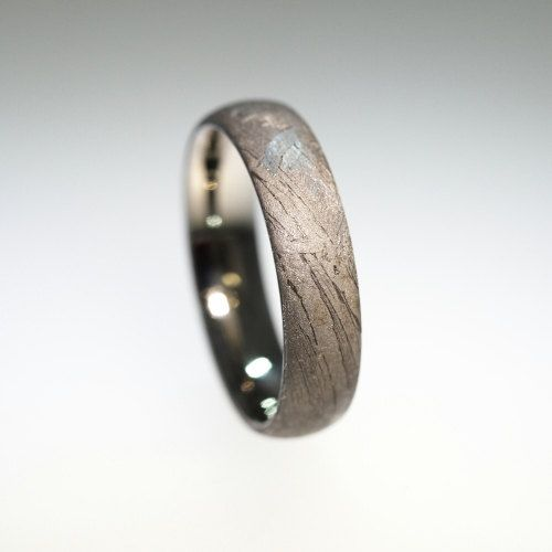"""No idea if this store has authentic stuff (if so.. wow.) but I so love the idea of jewellery made of meteorites. I first came across the idea in a tiny store in an old part of Beijing. Most awesome material I can think of.     Here: """"Meteorite Ring Ov"""