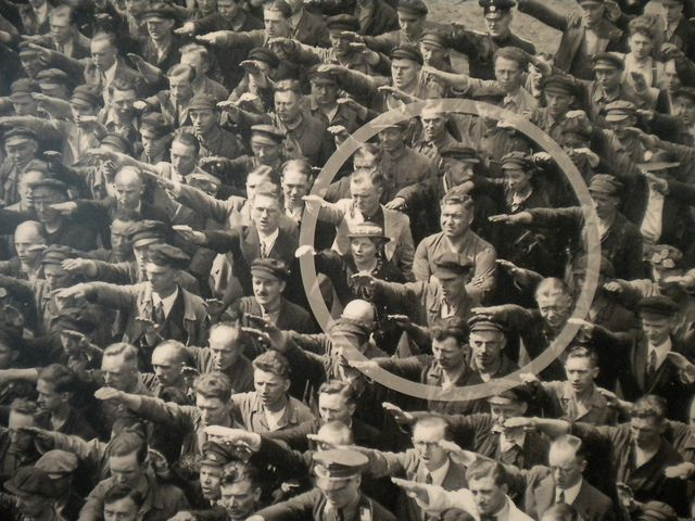 Ordinary people. The courage to say no.    The photo was taken in Hamburg in 1936, during the celebrations for the launch of a ship. In the crowed, one person refuses to raise his arm to give the Nazi salute. The man was August Landmesser. He had already