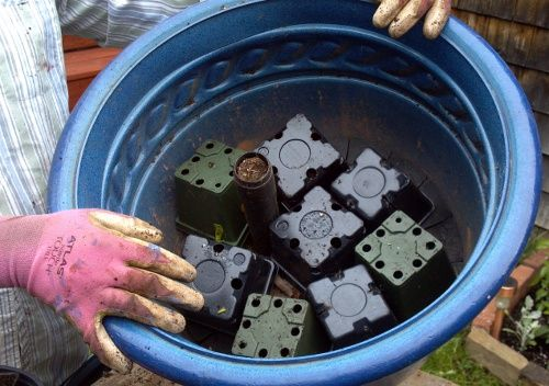 Save soil, save money, grow better plants.  Use those cheap plastic pots (the ones the plants are potted in when you get them at the nursery/garden center) in the bottom of a large planter to provide good drainage and better airflow.: Garden Ideas, Save M