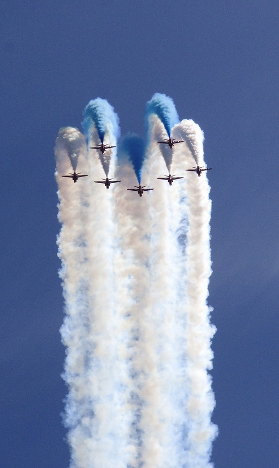 The Red Arrows, officially known as the Royal Air Force Aerobatic Team, is the aerobatics display team of the Royal Air Force based at RAF Scampton. The team was formed in late 1964 as an all-RAF team, replacing a number of unofficial teams that had been