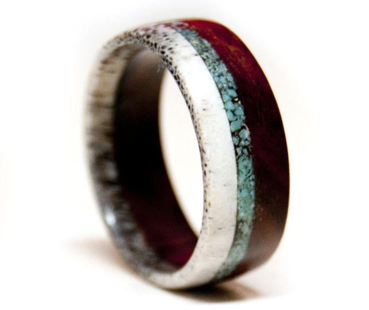 This rustic ring is exquisitely crafted from naturally-shed deer antler, Desert Ironwood, and Genuine Turquoise. Each wedding band is handcrafted in Utah by Staghead Designs. Wear and be wild! | Green Bride Guide: Turquoise Inlay, Antlers, Unique Wedding