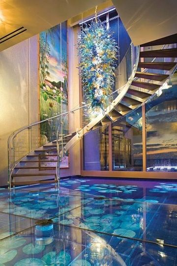 Advertisement Million Dollar Foyer Distinctive features of Acqua Liana's one-of-a-kind foyer include a suspended glass sculpture and visually striking 'water floors' — with water flowing beneath clear glass. Acqua Liana is a Tahitian expressio