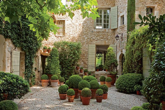 Clusters of topiaries populate the courtyard at the Provence property of decorator François Catroux. Photo by François Halard. Via www.wsj.com.: Garden Ideas, Exterior, Patio, Gardens, House, Outdoor Spaces, Garden, Courtyards
