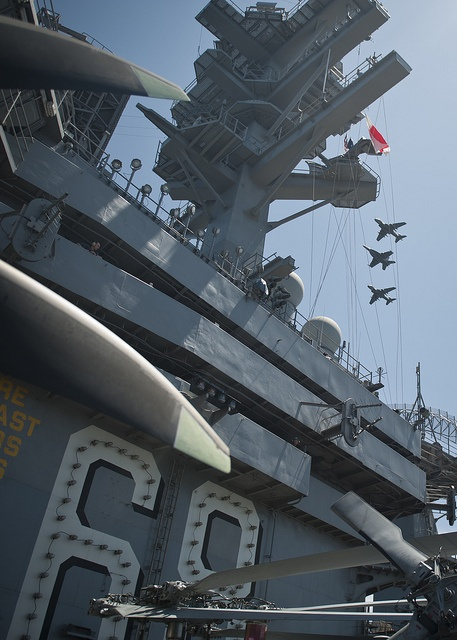 INDIAN OCEAN (May 27, 2013) Fixed-wing aircraft fly over the flight deck of the aircraft carrier USS Nimitz (CVN 68). Nimitz Strike Group is deployed to the U.S. 7th Fleet area of responsibility conducting maritime security operations and theater security