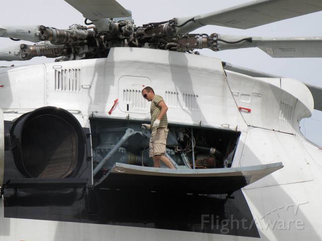 Look how large a Russian Mil Mi26 helicopter is. An easy comparison with crew member standing on door during maintenance.: A Helicopters, Planes Aircraft, 0210 Flying, Airplanes I D