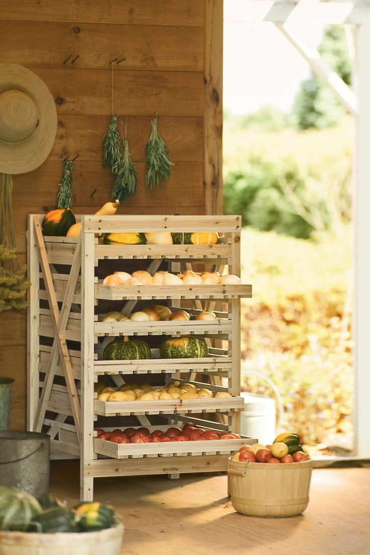 "Orchard Rack | Buy from Gardener's Supply  Years ago, people stored ""keeper"" crops such as apples, winter squash, onions and potatoes on rustic wooden racks like this one. The drawers are slatted to ensure good air circulation, and they slide"