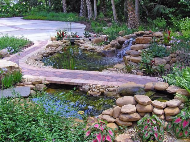 The homeowners wanted their landscape to fit in gracefully with the designated wilderness area next door. What could be more natural than a pool and waterfall to mark the path that is visible from inside the home?: Designated Wilderness, Ponds, Pond Idea,