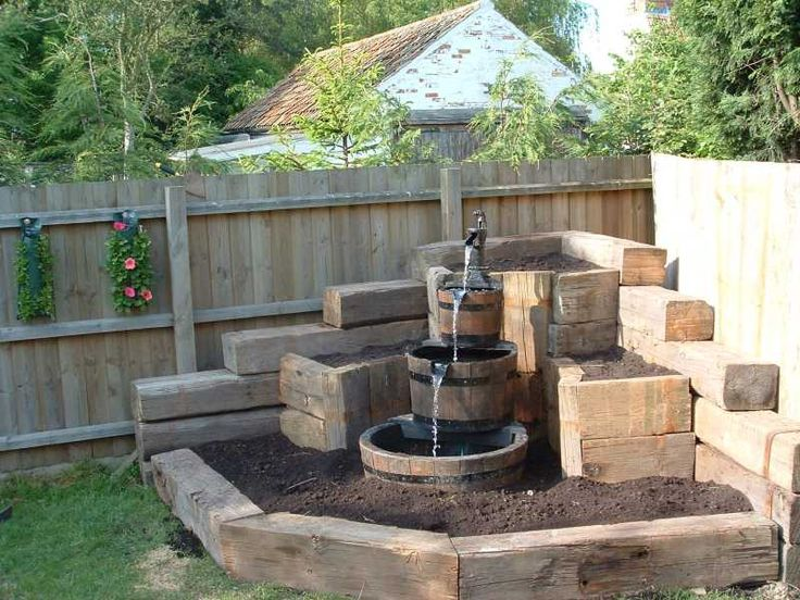 This might work for the goldfish pond. Just make the bottom container big and deep. But where in the yard to put it? Against white fence instead of in a corner?: Water Feature, Pond Idea, Backyard Landscaping Idea, White Fence, Fountain Idea, Container Bi