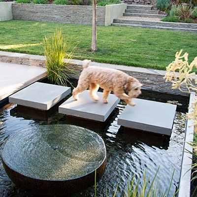 Water crossing  Bluestone pavers traverse this water feature in Alamo. The designer attached them to concrete pillars built into the bottom; each one is cantilevered 4 inches out from its pillar. The dark Mexican pebbles lining the pool and the dark-hued