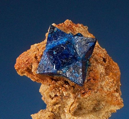 Tiny but super-rare, this cumengeite crystal perches on a throne of brecca, or broken-up rock and mineral naturally cemented together. Cumengeite is closely related to boleite, which forms cubes of a similar blue hue and is found in lead and copper deposi