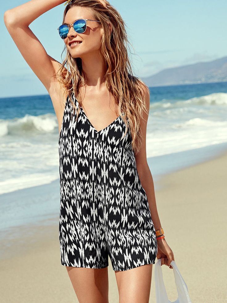 Fact: This beach cover-up is pretty much made for Coachella. Its plunge front, low back and bold tribal print make it perfect for pairing over a bikini or bralette. All that's missing is your weekend pass! | Victoria's Secret Double-V Romper: Jumpsuits Pl
