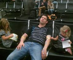 The dad who's going to have to rip off each individual sticker, like a million Band-Aids. | 25 People Who Are Having A Worse Time At The Airport Than You