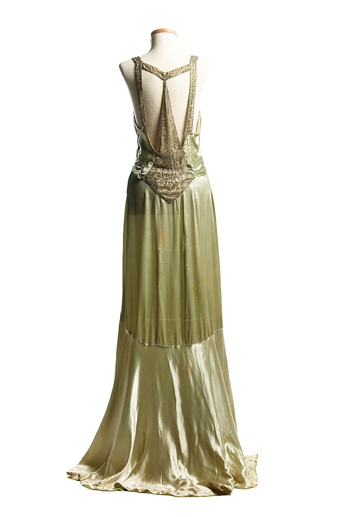Light green satin evening dress, c. 1932. This stylish gown with a magnificent Art Deco design rhinestone ornamentation on the back was worn by the donor's sister, Eleanor Middleton Rutledge Hanson (1894-1966) for her second court visit at Buckingham Pala