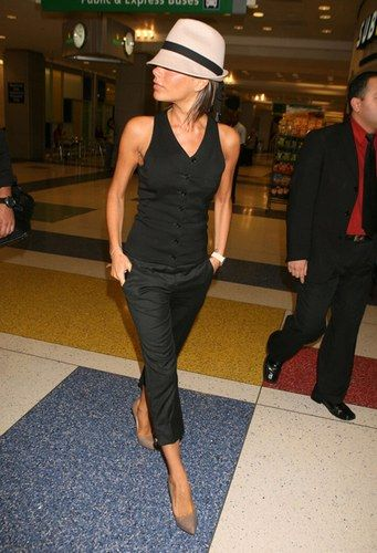 Love the black on black and neutral heels, which takes cropped city pants that usually make women look shorter and fatter and helps make the look long and lean. The nude shoes continue the illusion (black would have chopped her off at the ankles). The hat