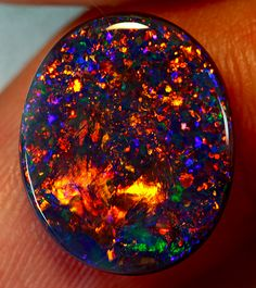 Solid Gem Black Opal from Lightning Ridge - unique jewelry I would much rather receive an engagement ring with this instead of diamonds...