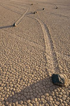 """Located in one of the flattest places on the face of this planet are the strange and unexplained Sailing Stones of Racetrack Playa, Death Valley, California, USA. Once a year the """"Playa"""" or flat desert pan experiences short winter rains and become"""