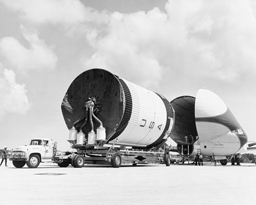 The second stage of the Saturn 205 vehicle, to be used on Apollo 7, arrives at Cape Canaveral Air Force Station aboard the Super Guppy aircraft on Sunday, April 7, 1968. (Source: NASA): American Spaceflight, Nasa Space Shuttle, Outer Space, Poster, Produc