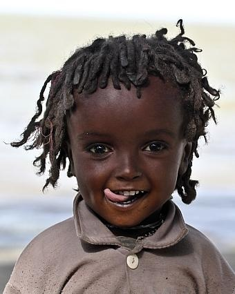 What a beautiful child!   -The world is Africa's Diaspora. There are more white children with these facial features than most black children I've seen here in the USA. It's amazing to see how diverse the African bloodline is. I wonder where th