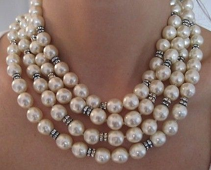 """Chanel Pearl & Diamond Sautoir Necklace..These vintage glass pearls are in mint condition. They are unusually long, measuring 71"""", perfect runway couture! They can be worn in several different lengths depending how many times they're wound aro"""