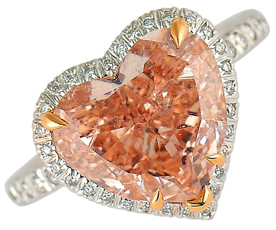 Orangey pink diamond. I dont usually like flashy stones but I love this color!!!! accented beautifully by the gold prongs