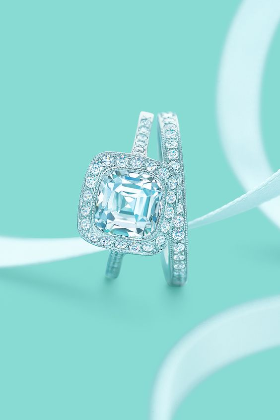 Tiffany Legacy® diamond engagement ring with a matching diamond wedding band.