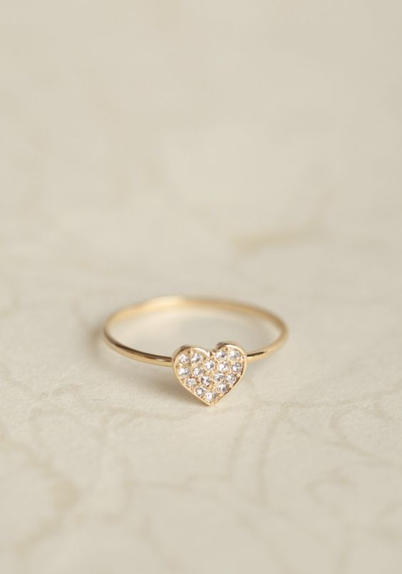 Valentine Heart Ring 11.99 at shopruche.com. A dainty rhinestone heart adorns this simple gold-toned ring. Pair with any outfit for a lovely, romantic touch.0.25