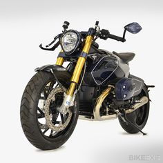 BMW R1200-based custom built by industrial designer Giulio Paz.  'Diva' is a ground-up build: Only the 110-hp, 1170-cc boxer engine & the electrics remain stock, for ease of servicing. The frame was created by Bonamici Racing, which helps to build the