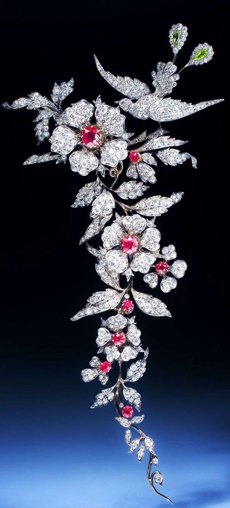 http://rubies.work/0102-ruby-rings/ An important 19th century ruby and diamond branch brooch, designed as an articulated foliate spray surmounted by a bird of paradise, set with circular-cut and cushion shaped rubies, circular and rose cut diamons, pear-s