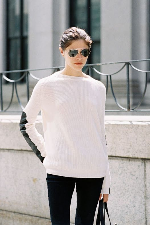 Emily Weiss in aviators with a black & white colorblock sweater #style #fashion #streetstyle