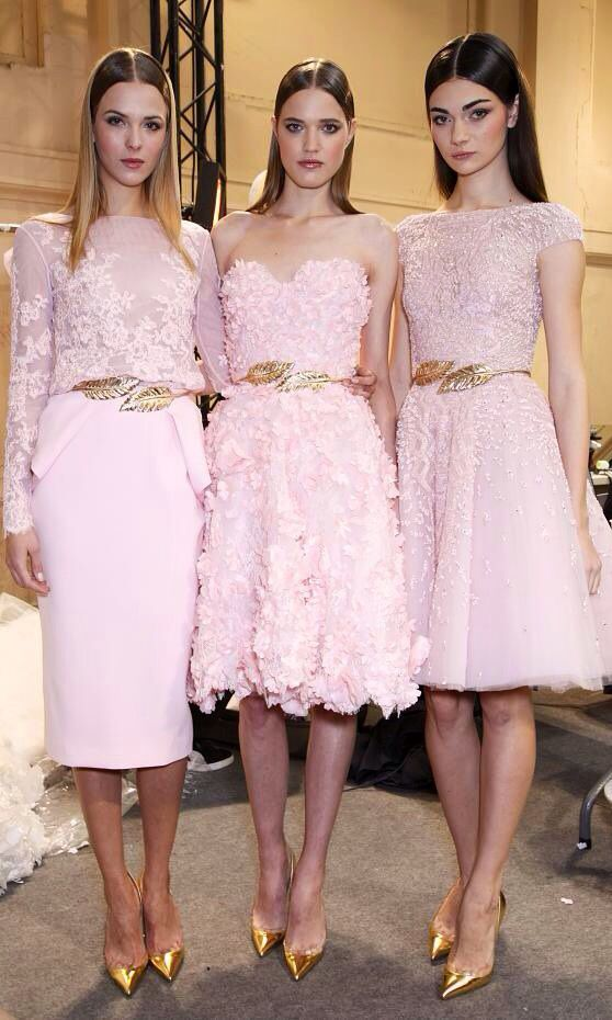 Pink + gold. It would have to be a different color but this would be awesome bridesmaids dresses