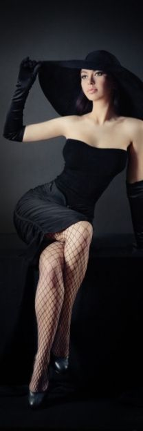 spice up your old black dress with a pair of fishnet stockings, large black hat and evening gloves