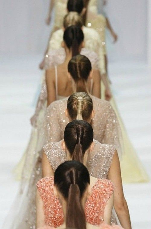 the high ponytail is always chic but I love the modern twist it is given in the ellie saab runway show. It's cohesive yet unique.