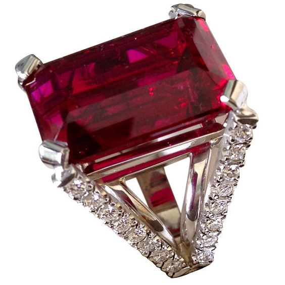 A beautiful, emerald-cut rubellite tourmaline displaying a rich, well-saturated magenta red color and fine luster. Emerald-cuts are infrequently used for tourmaline and the selection of this style underscores the confidence of the cutter in the quality of