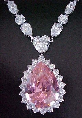 Beautiful pink and white diamond necklace; the drop hangs from a white diamond heart.