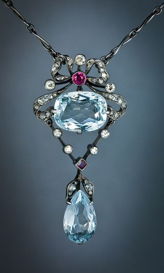 A Belle Epoque Antique Aquamarine Pendant Necklace  This elegantly designed Edwardian era necklace was hand crafted with silver and gold in St. Petersburg, Russia between 1908 and 1917.   Later, the necklace had been rhodium plated to make it all white, o
