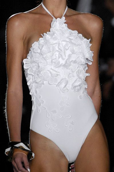 I like that Frilly But Chic thing going on  here...it makes me think of a certain high-fashion, runway-esque twist on workwear chic, which makes for an unexpected thrill in swimwear!