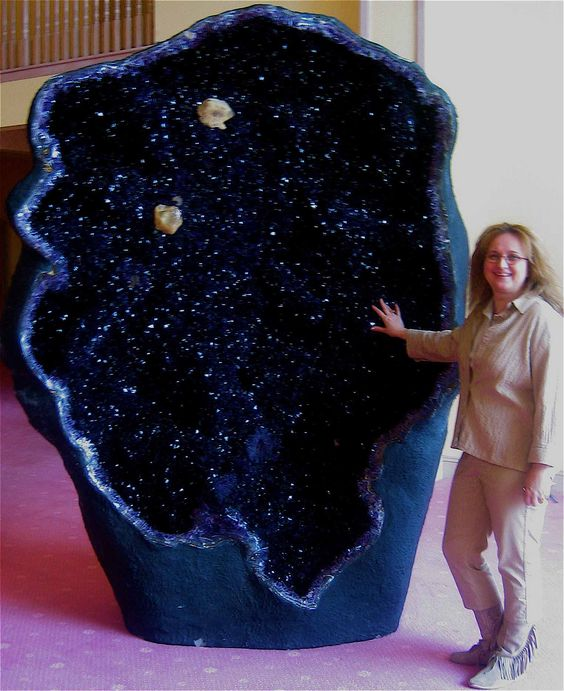 One of the world's largest amethyst geodes, the Empress of Uruguay, is located in Australia's Crystal Caves. It stands an alarming eleven feet tall and is filled with magnificent, deep violet crystals.: Alarming Eleven, Violet Crystals, Worlds Lar
