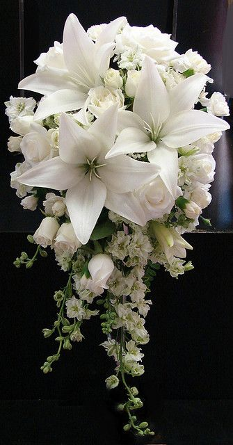 This is the prettiest white roses bouquet I have seen and the white lilies make it even more dramatic.: White Rose, Wedding Bouquets, Wedding Ideas, Wedding Flowers, Rose Wedding, White Lilies
