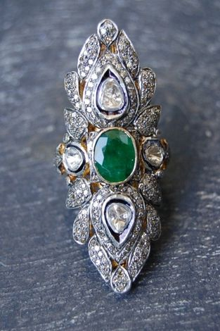 https://www.bkgjewelry.com/sapphire-ring/327-18k-yellow-gold-diamond-blue-sapphire-solitaire-ring.html I lust after this Rona Pfeiffer emerald and diamond ring.