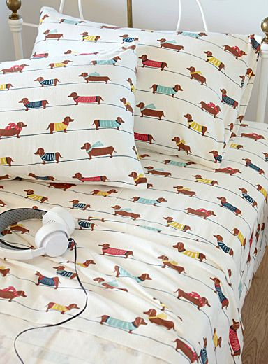Simons, DACHSHUND DOGS FLANNEL SHEET, STARTING AT $19.99 Style: 3543-2131141  Our 100% brushed cotton flannel sheets, imported from Portugal that are soft and warm, and will help you sleep better during the cold season. - Cute endearing dogs with their sw