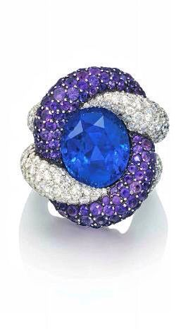 A SAPPHIRE, AMETHYST AND DIAMOND RING, BY JAR The entwined diamond and amethyst cords holding an oval-shaped sapphire, to a similarly-set diamond double hoop, mounted in platinum and silver, 1988