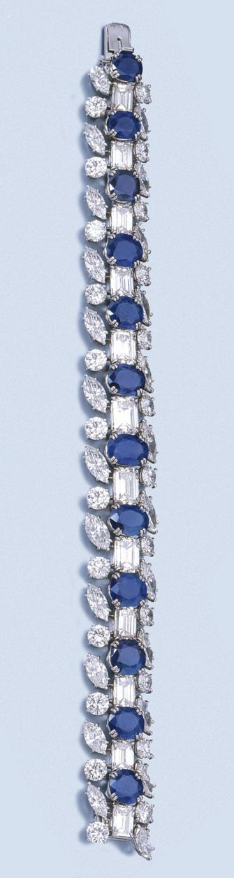 FINE SAPPHIRE AND DIAMOND BRACELET, HARRY WINSTON, 1960S. mmer Price with Buyer's Premium) The articulated band designed as a series of oval, circular-cut and cushion-shaped sapphires alternating with step-cut diamonds, the three larger ones weighing