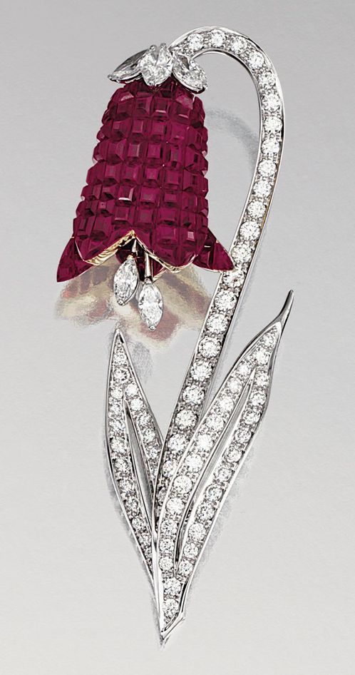 "RUBY AND DIAMOND BROOCH, ALETTO BROTHERS.  Designed as a bellflower, the stem and leaves set with brilliant-cut diamonds, the petals invisibly-set with calibrated rubies, to a marquise-shaped diamonds pistil set ""en tremblant"", mounted in yellow g"