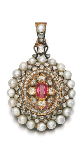 RUBY, SEED PEARL AND DIAMOND BROOCH/PENDANT, LATE 19TH CENTURY Set to the centre with a cushion-shaped ruby, within a frame of cushion-shaped, rose diamonds and seed pearls, brooch and pendant fittings interchangeable.